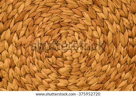 Closeup texture of gold wicker woven pattern for background - stock photo