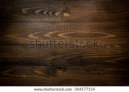 Closeup texture of old dark wooden planks. Horizontal background with vignetting - stock photo