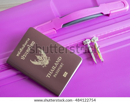 Closeup Thailand passport on pink suitcase (Travel Kits)