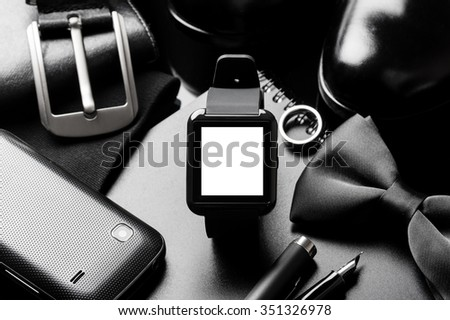 closeup the black smart watch with blank screen - stock photo