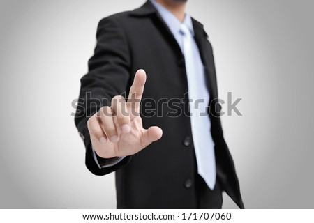 closeup the finger of businessman touching an imaginary screen