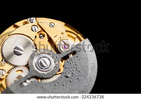 closeup the movement of old swiss made automatic watch