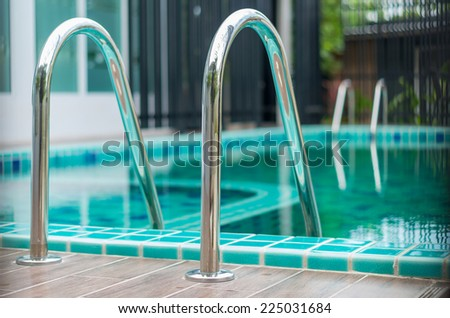 Closeup the Swimming pool with stair - stock photo