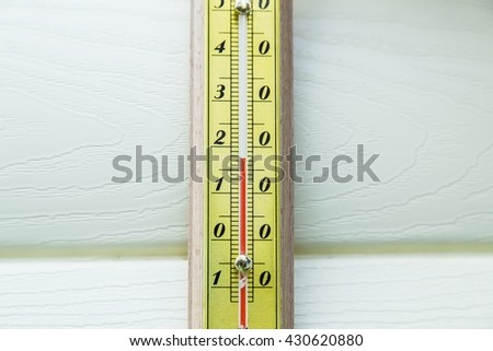 Closeup thermometer showing temperature in degrees Celsius
