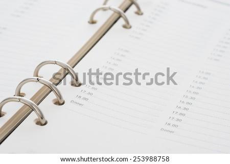 closeup time schedule in a diary book - stock photo