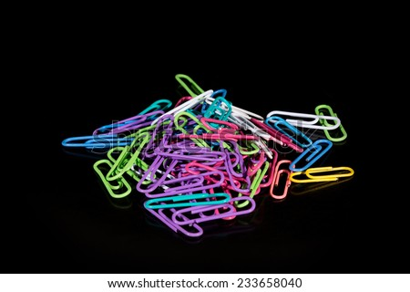 Closeup to a colorful paper clips - stock photo