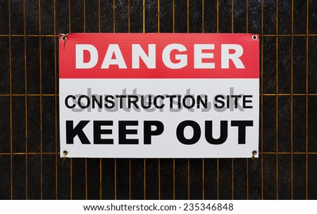 Closeup to a 'Danger Construction Site Keep Out' Sign - stock photo