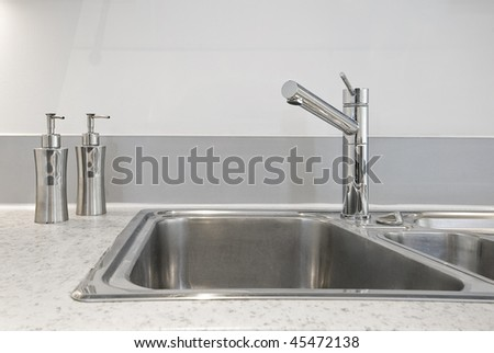 closeup to a stainless steel kitchen sink - stock photo