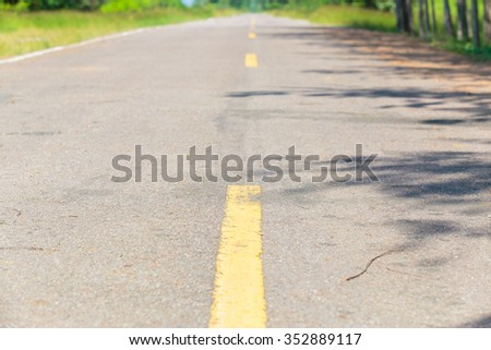 Closeup to surface of country road.
