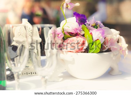 Closeup toned shot of table decorated for wedding ceremony
