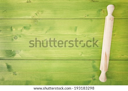 closeup top view rolling pin on wooden table - stock photo