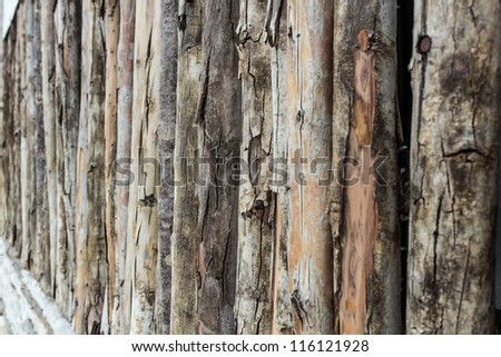 Closeup Traditional wooden rural wall from old logs - stock photo