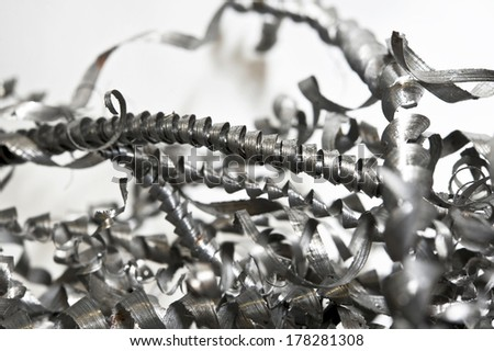 Closeup twisted spiral steel shavings. CNC lathe drilling and milling industry. - stock photo
