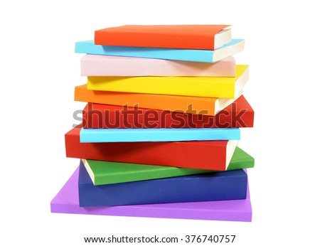 Closeup untidy small pile of colorful books isolated on white