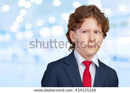 Closeup up portrait of s suspicious, cautious child boy - stock photo