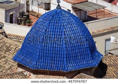 Closeup up view of church with Blue blue tile dome