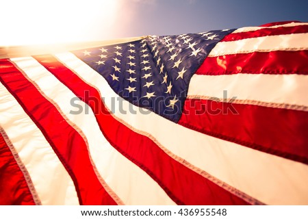 Closeup USA,American flag,the symbolic of liberty,freedom,patriotic,honor,american family,kids,nation,independence day,4th of July,labor day,waving by the wind blow. - stock photo