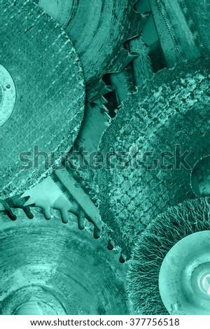 Closeup various abrasive discs, hacksaw and circular saw blades pattern. Toned. - stock photo