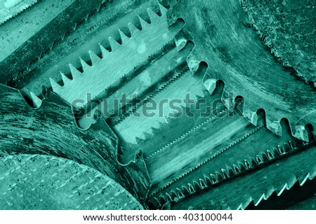Closeup various hacksaw and circular saw blades pattern. - stock photo