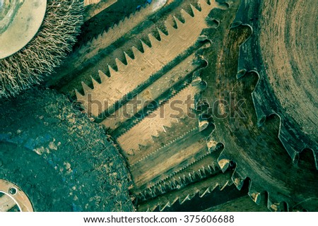 Closeup various hacksaw, circular saw blades and abrasive disks pattern. - stock photo