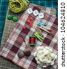 Closeup various sewing supplies lying on the fabric. - stock photo