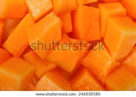Closeup vies of fresh yellow melon cubes, dessert - stock photo