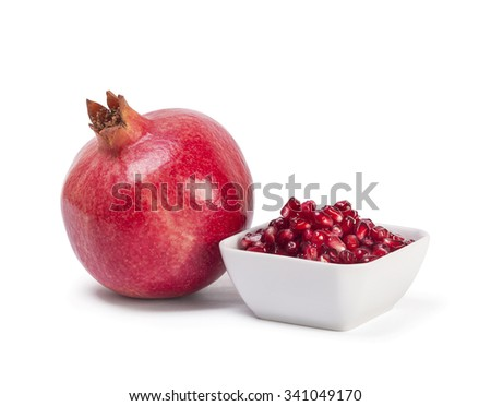 Closeup view of a bowl of pomegranate seeds