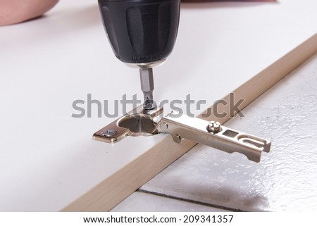 Closeup view of a carpenter building a wooden furniture