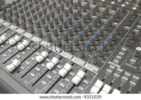 closeup view of a DJ's mixing desk - stock photo