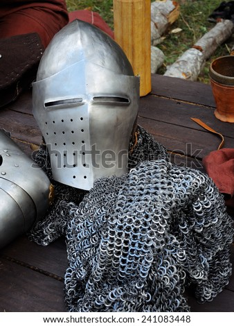 closeup view of a medieval helmet and other typical items  - stock photo