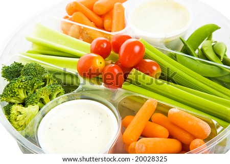 Closeup view of a party tray of delicious raw vegetables and dip.