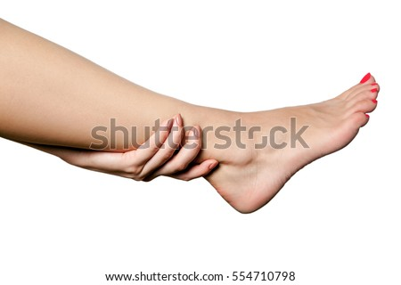 Closeup view of a young woman with pain on leg. isolated on white background.
