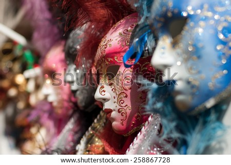Closeup view of beautiful ornate venetian carnival red mask with golden pattern - stock photo