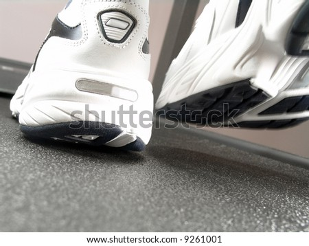Closeup view of brand new sport shoes running on a treadmill - stock photo