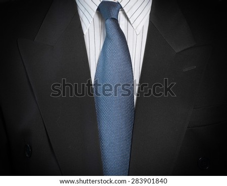 Closeup view of business man in suit.