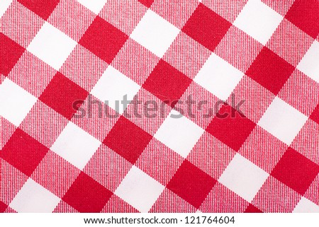 Closeup view of checked with red and white tablecloth - stock photo