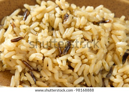 closeup view of cooked rice pilaf on a plate - stock photo