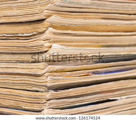 Closeup view of corner of old magazines pile end, maybe used as background - stock photo