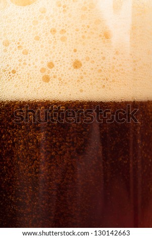 Closeup view of dark beer in the glass