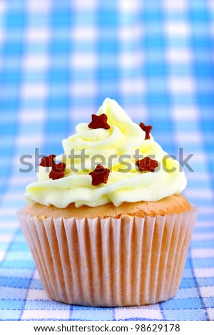Closeup view of delicious cup cake with stars - stock photo