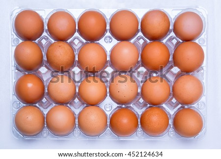 closeup view of eggs in 4x6 array - stock photo