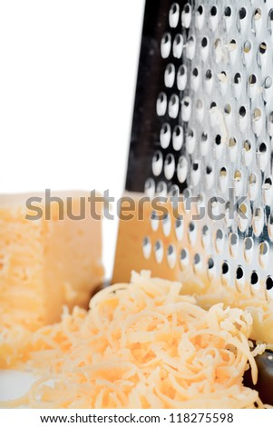 Closeup view of grater and grated cheese - stock photo