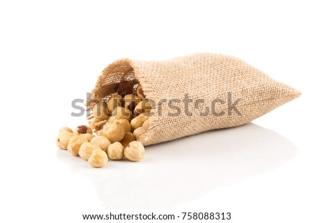 Closeup view of hazelnuts on white background in hessian bags