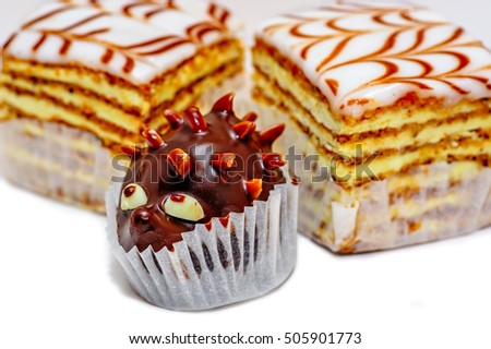 Closeup view of layered cakes and chocolate hedgehog