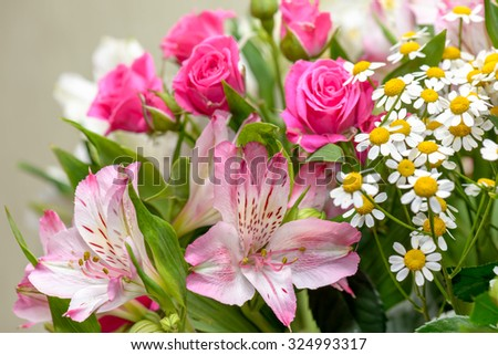 Closeup view of lilies, roses and camomiles bouquet