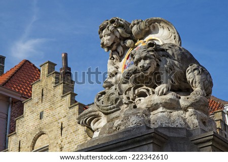 Closeup view of Lion On City Coat of Arms On A Water Fountain (Bruges, Belgium) - stock photo