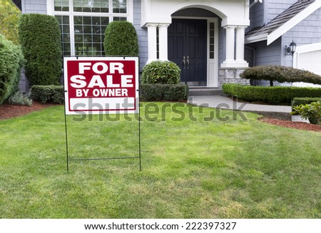Closeup view of Modern Suburban Home for Sale Real Estate Sign in front of modern home
