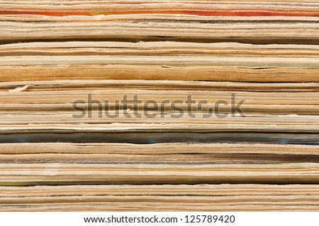 Closeup view of old magazines pile end, maybe used as background - stock photo