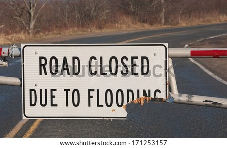 Closeup view of road closed due to flooding sign.
