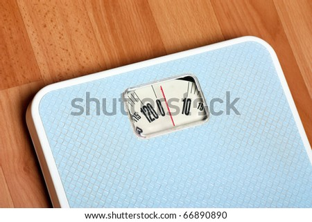 Closeup view of scales on a floor. Dieting concept.